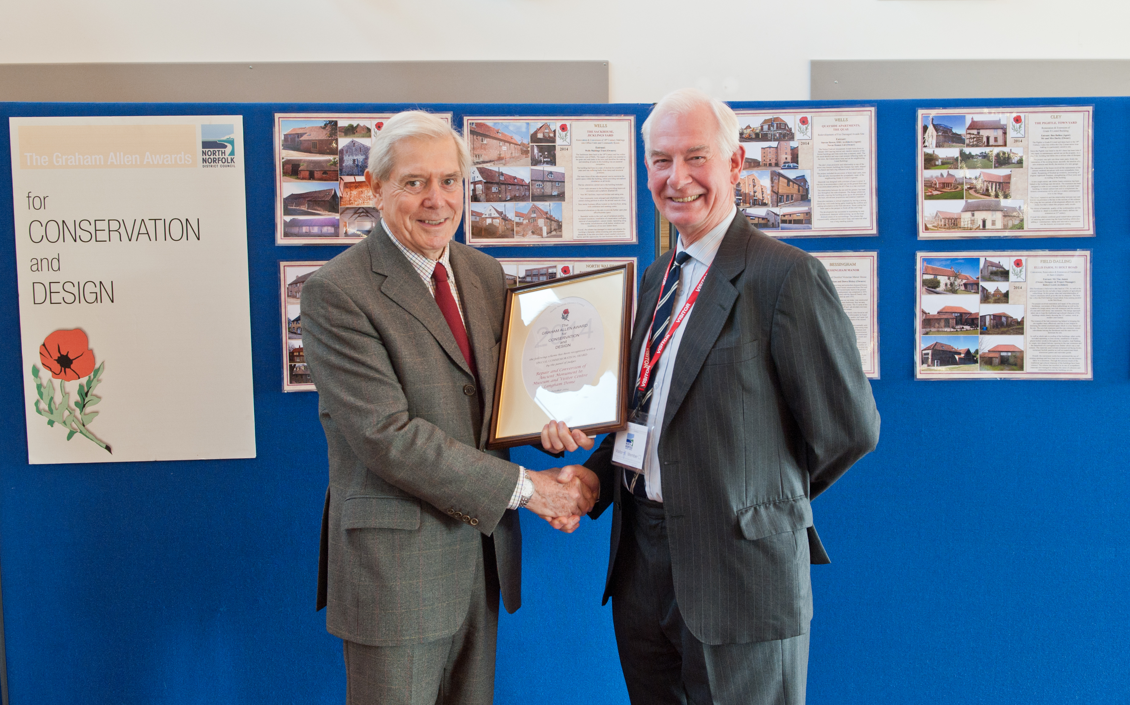 Malcolm Crowder (left) accepts the award on behalf of North Norfolk Historic Buildings Trust, from Edward Allen representing the Allen family